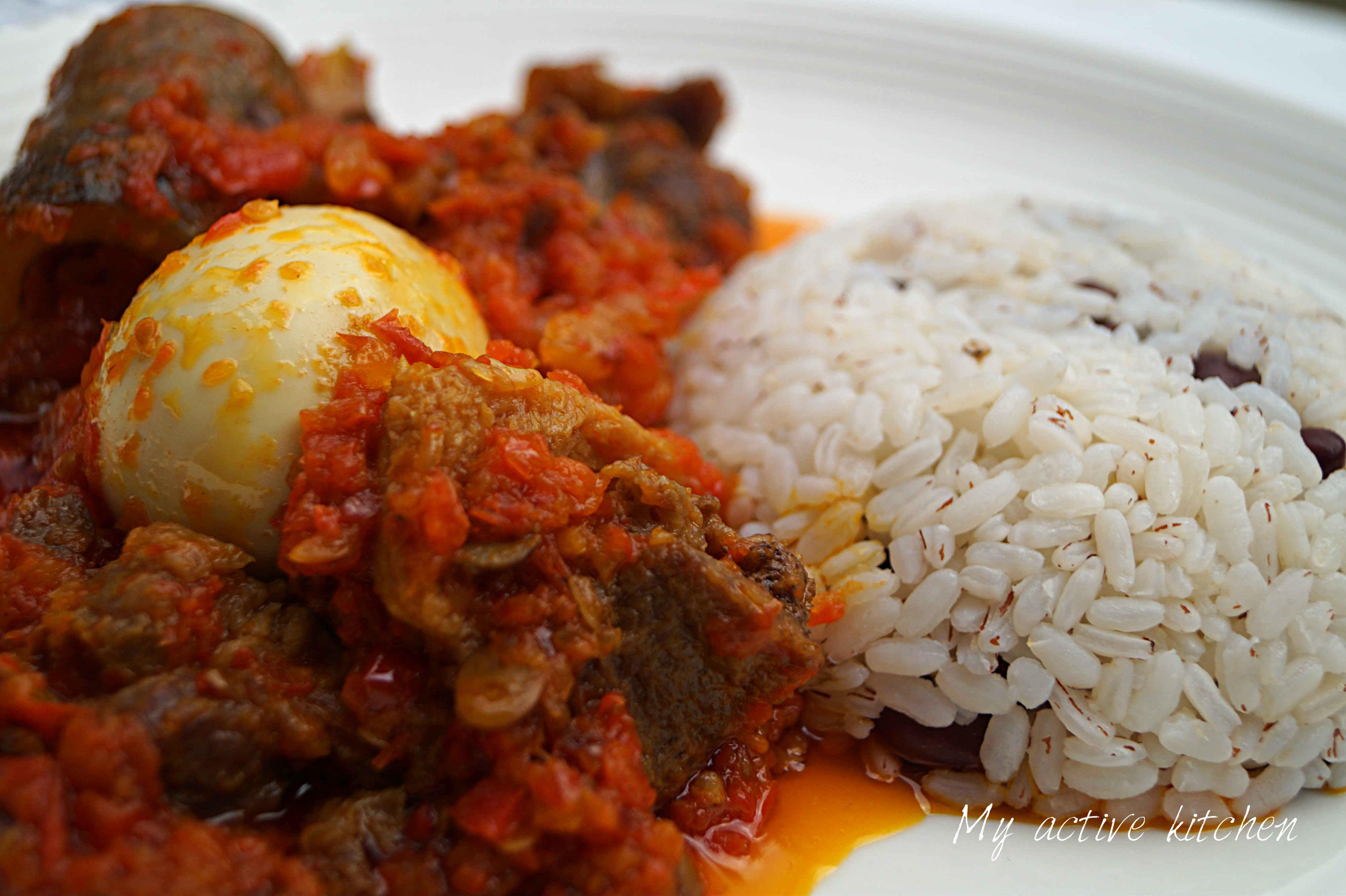 ofada rice and ofada stew on a plate