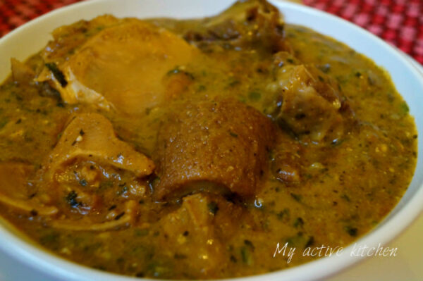 yoyo soup or ogbono soup with assorted meat in a white bowl..