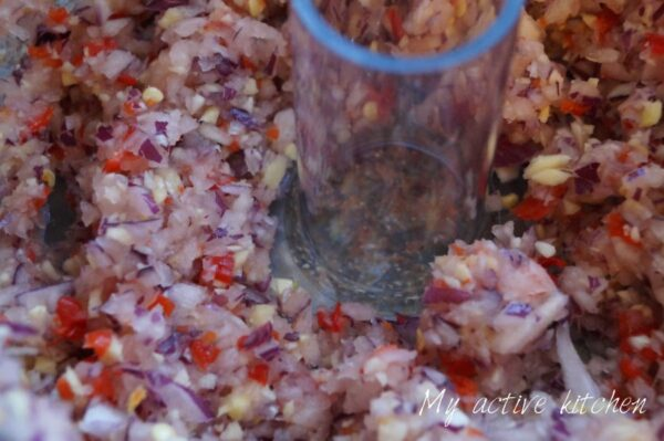 close shot of blended pepper mix in food processor