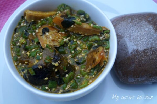 okro soup in a bowl served with amala dudu.