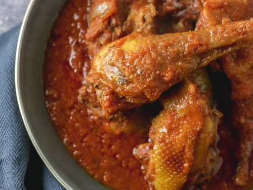 Nigerian chicken stew on a plate, the chicken used is the hard type that is flavourful and fried