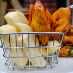 fried yam and plantain in a basket.