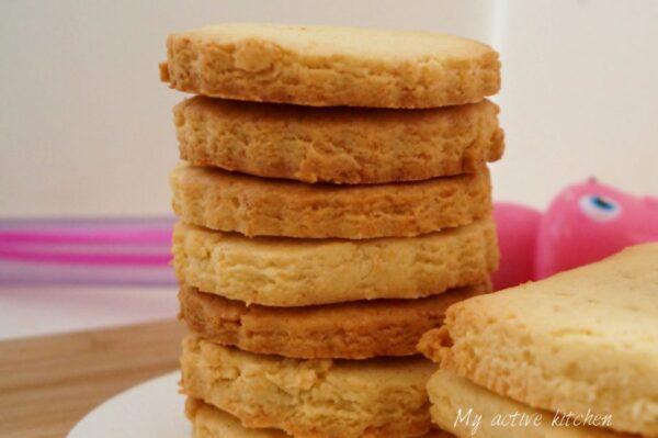 stack of freshly baked coconut shortbread cookies.