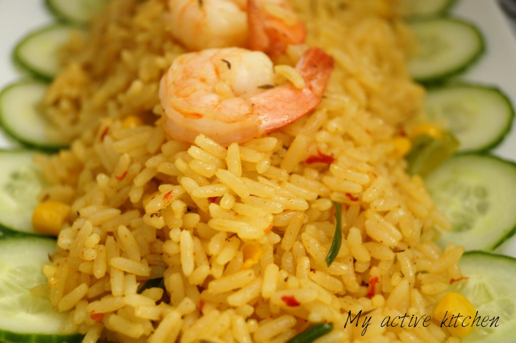 a close photograph of rice and shrimps
