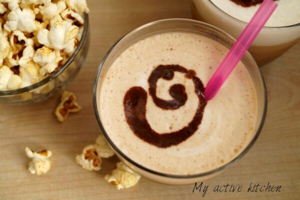 overhead shot of iced coffee with milky froth and chocolate swirl
