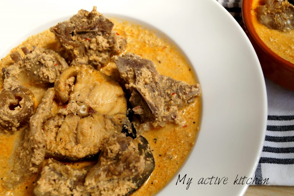 oil less egusi soup in a white plate