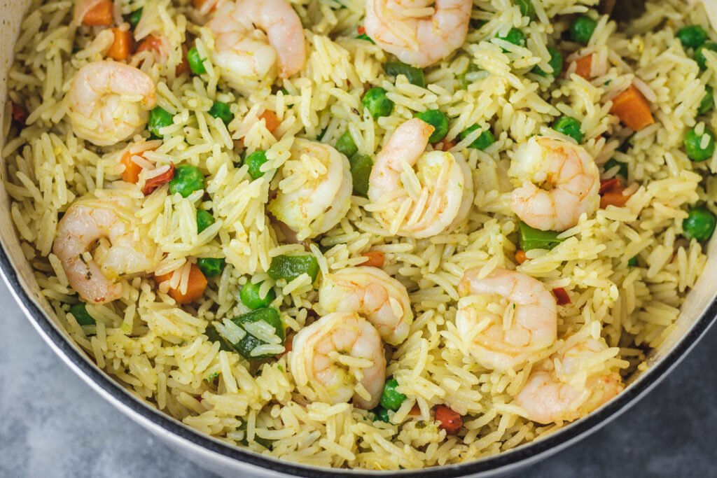 a pot of rice with shrimps.