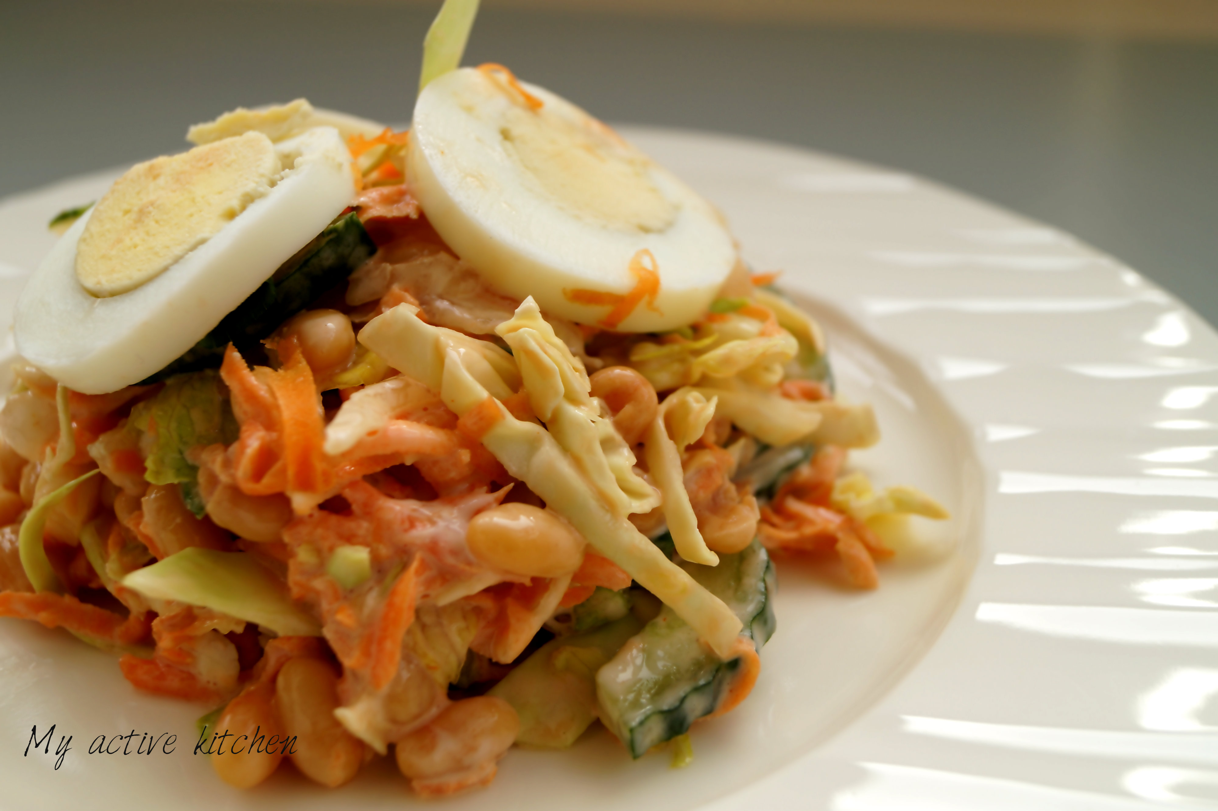 salad with boiled eggs and mayonnaise dressing