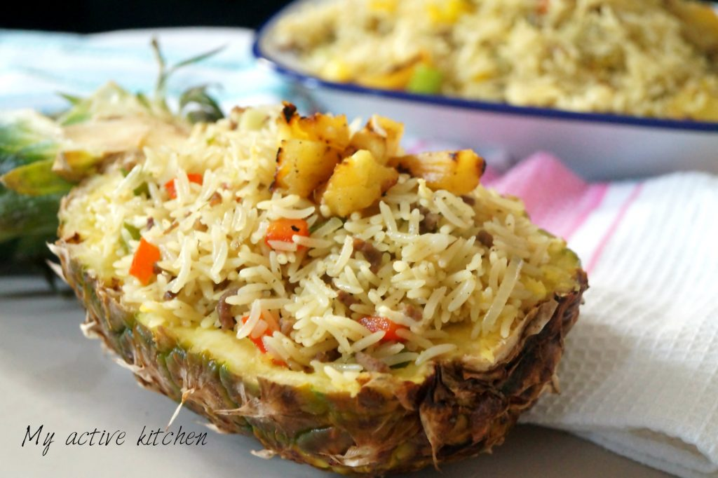 pineapple fried rice in a carved pineapple bowl