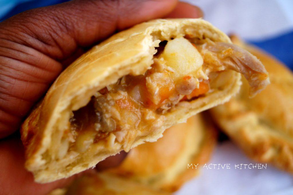 nigerian chicken pie on a napkin.