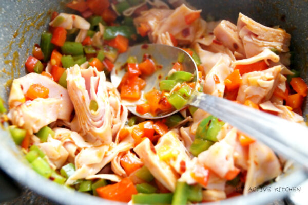 chopped ham and peppers in a pot