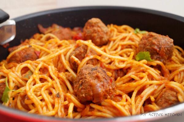 spaghetti and meatball in a pan.