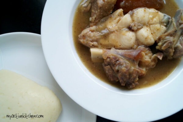 whire soup cooked with catfish and goat meat placed beside pounded yam