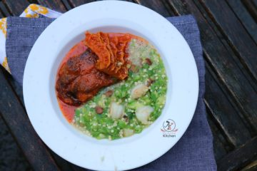 overhead shot of green vegetable soup and nigerian stew placed on a grey napkin