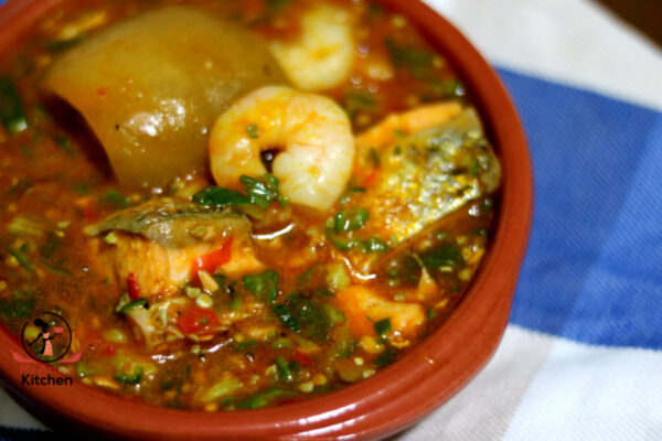 image of okra soup cooup with salmon, shrimps and ponmo