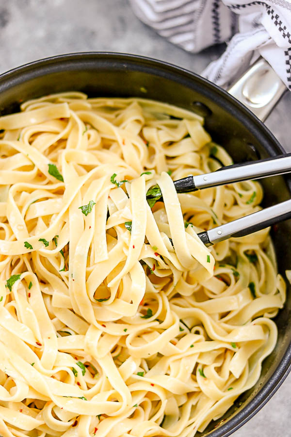 a close shot of tagliatelle in a pan