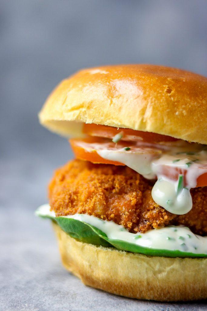 close shot fried fish burger and chive mayo dressing.
