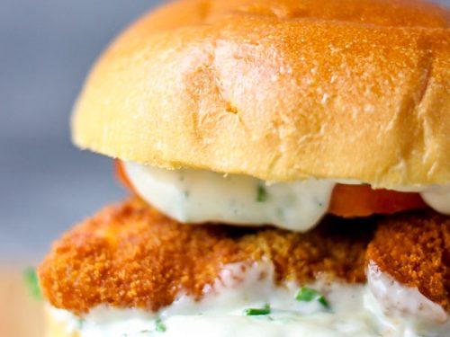 Close shot of burger bun with dressing