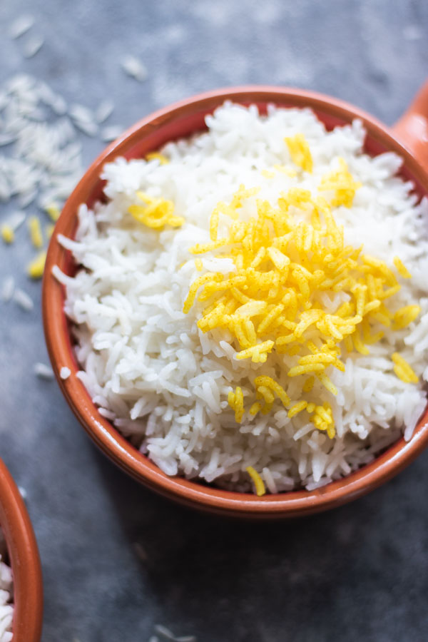 cooked basmati white rice and a garnish of turmeric rice