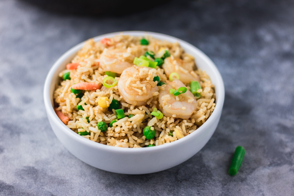 shrimp fried rice in a white bowl.