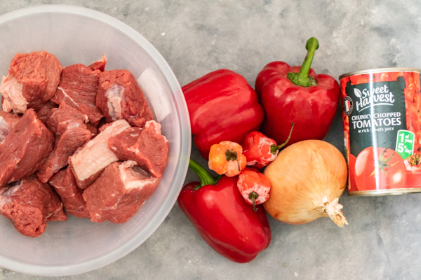 red bell pepper, scotch bonnet, onion and tomatoes