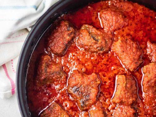 overhead shot of nigerian beef stew (african stew) in a pan