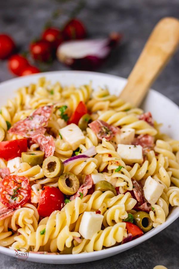 Italian pasta salad in a white bowl.