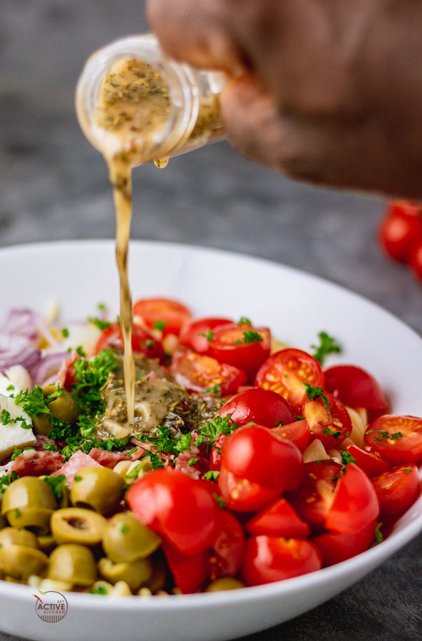 pour shout of homemade Italian dressing over pasta salad.