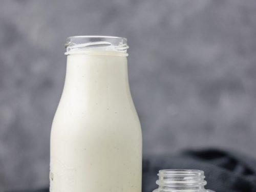 Vanilla coffee creamer in a milk bottle and little mason jar.