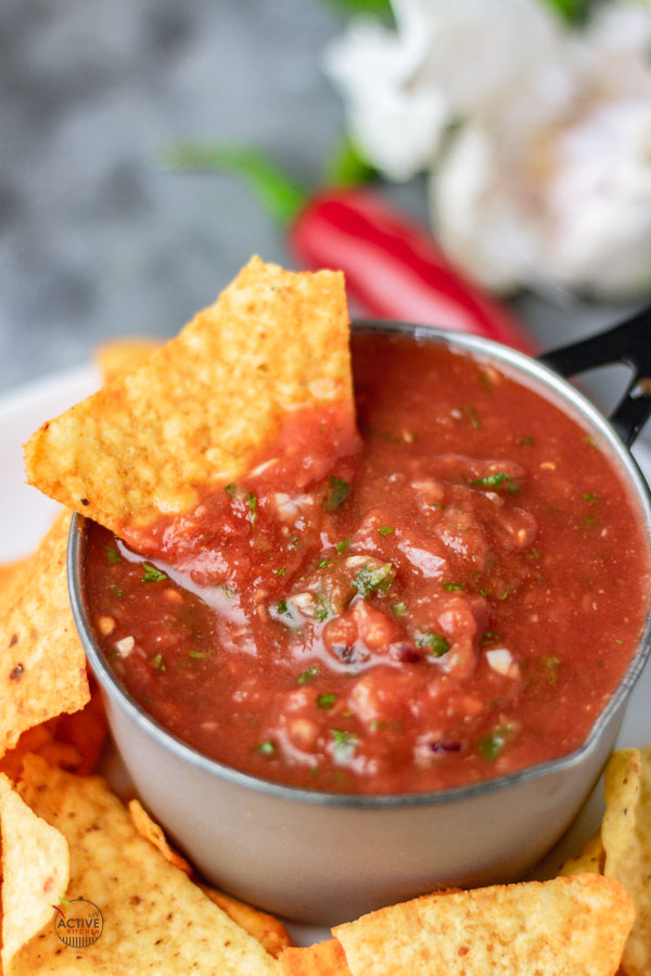 corn chip dipped in a bowl of homemade blender salsa.