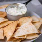 baked flour tortilla chips with a side dip.