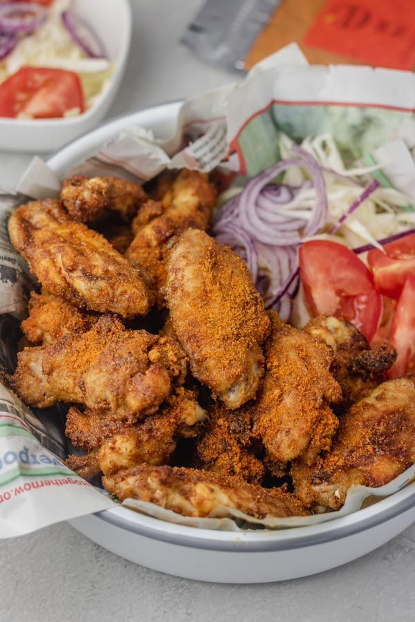 a bowl of grilled chicken suya with salad.