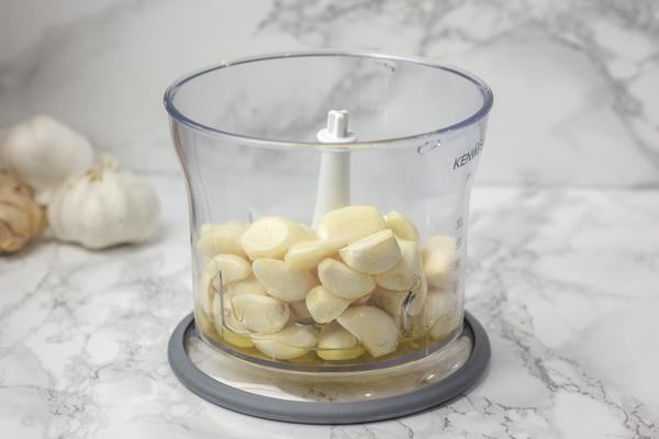garlic cloves and oil in a blender.