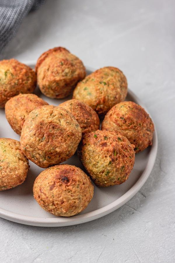 golden brown falafel balls on a plate.