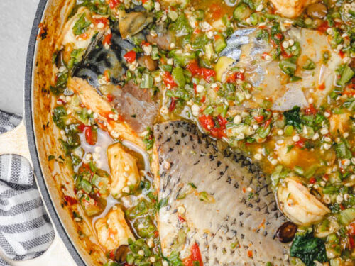 a pot of okra soup with fish.